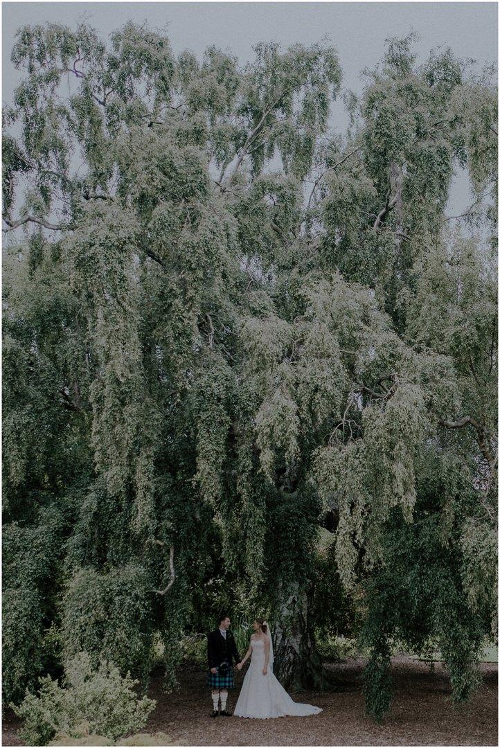 scottish wedding couple under tree
