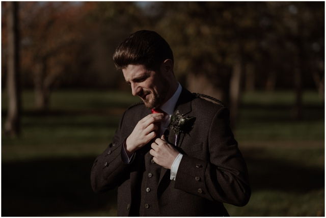 groom gets ready before wedding at winton castle