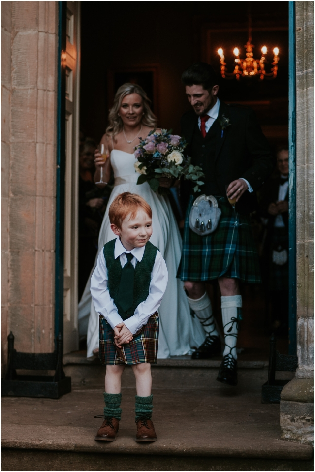 boy in a kilt laughing at a wedding in scotland