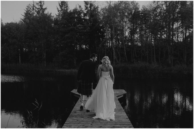 bride and groom wander at winton castle