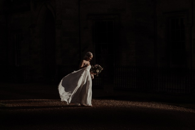 bride walks in the afternoon light at scotland wedding winton castle