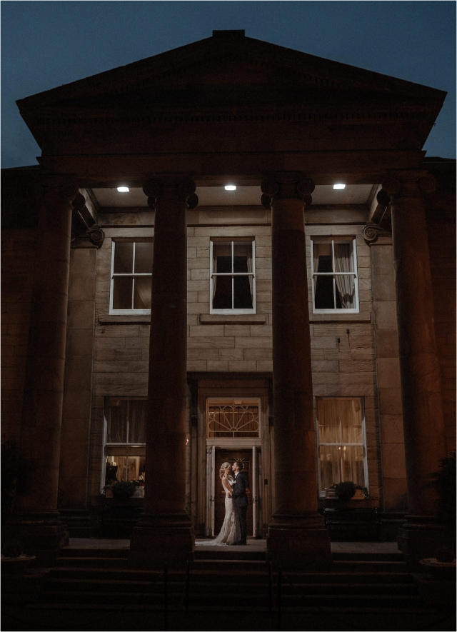 bride and groom in the twilight outside balbirnie house after their wedding in scotland