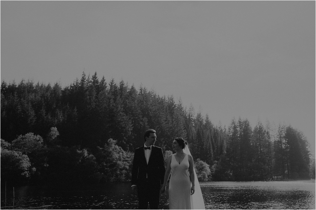 couple next to loch after their elopement in scotland
