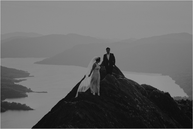 bride and groom on mountain in scotland during their elopement