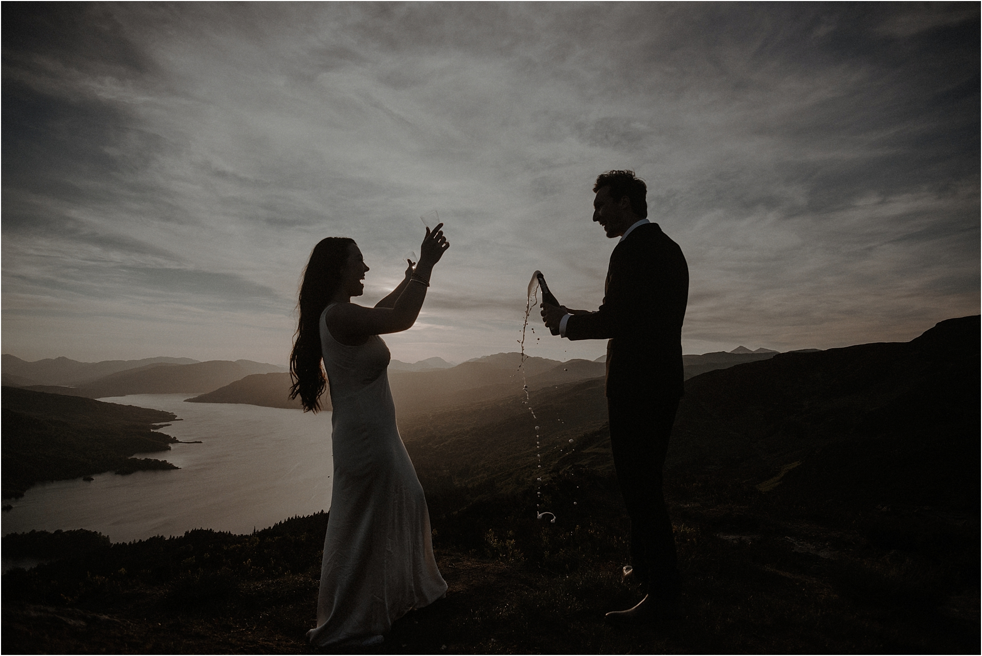 Bride and groom and champagne on scottish mountain