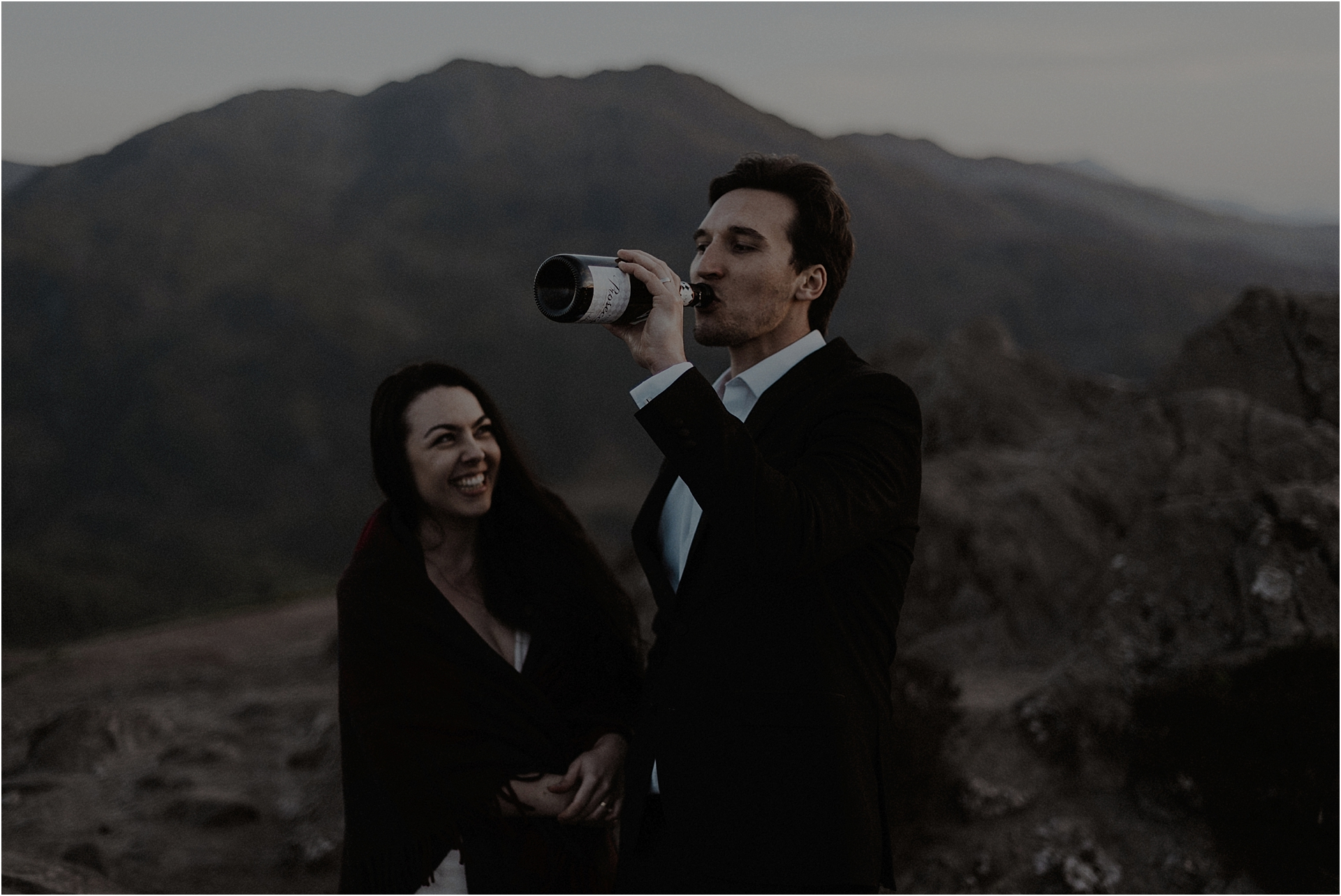 couple drinking champagne on a scottish elopement